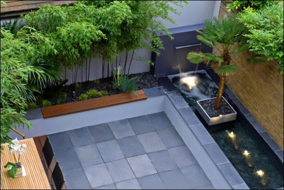 Contemporary-couryard-water-feature-bamboo-grass1-582x391