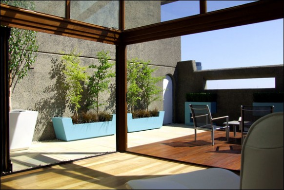 Rooftop-terrace-with-trees-and-patio-furniture-582x391